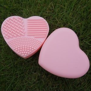 Heart shaped makeup brush cleaning pad